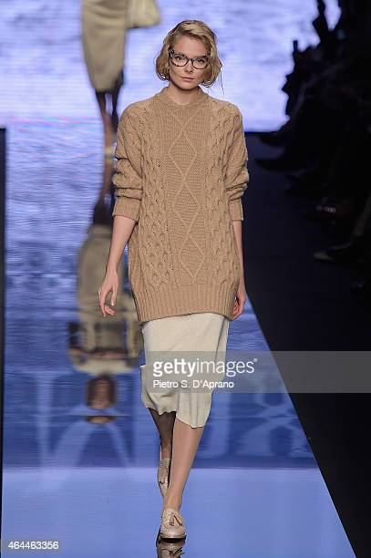 Model Jessica Stam walks the runway at the Max Mara show during the Milan Fashion Week Autumn/Winter 2015 on February 26 2015 in Milan Italy