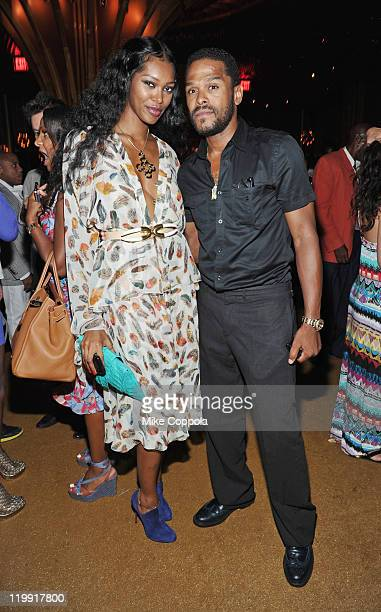Model Jessica White and singer Maxwell pose for a picture at the Moet Rose Lounge during the celebration of the launch of Kelly Rowland's new album...