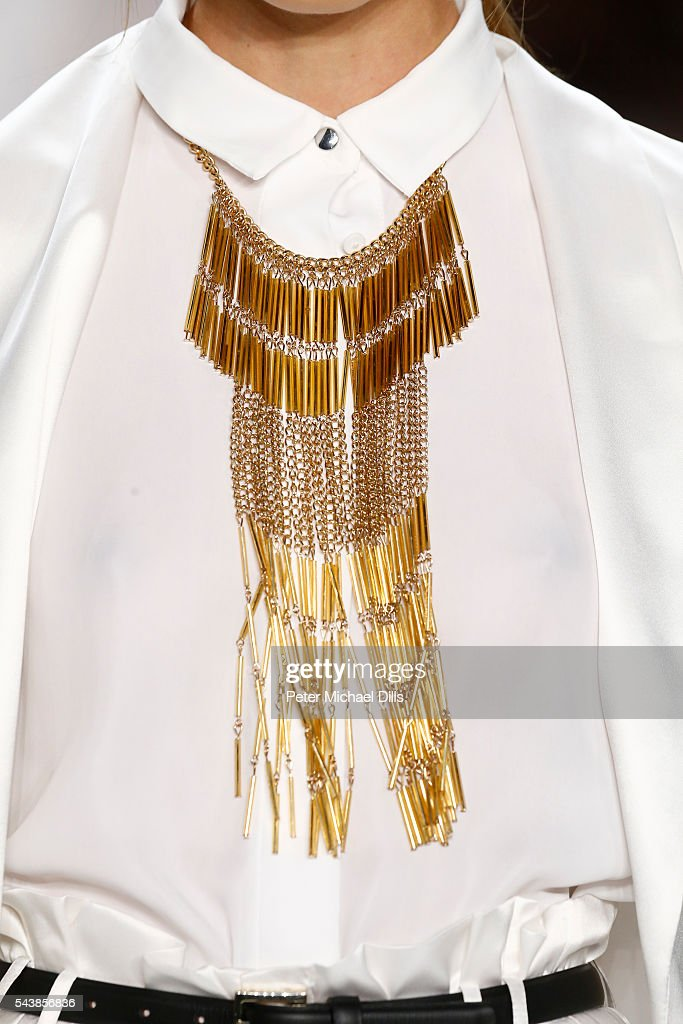A model, jewels detail, walks the runway at the Dimitri show during the Mercedes-Benz Fashion Week Berlin Spring/Summer 2017 at Erika Hess Eisstadion on June 30, 2016 in Berlin, Germany.