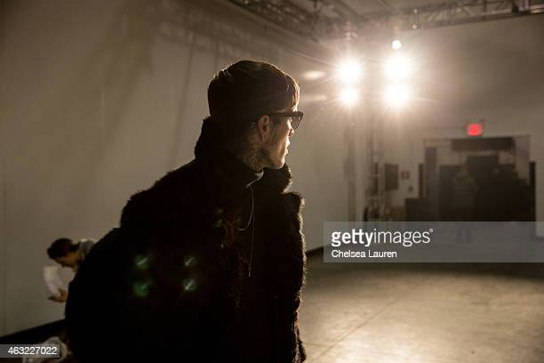 Model Jimmy Q poses backstage during the Timo Weiland presentation at Industria Studios on February 11 2015 in New York City