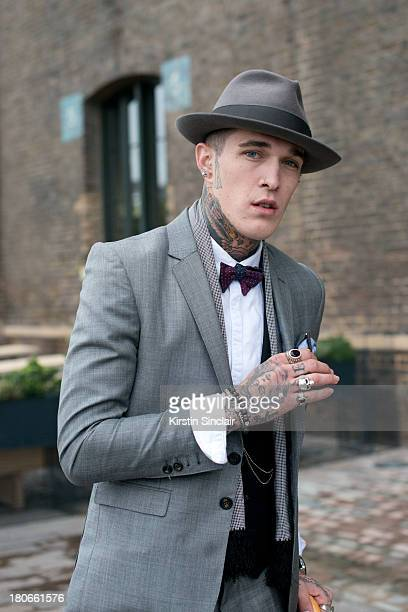 Model Jimmy Q wears a Joshua Kane Bespoke suit shirt and waistcoat and a Laird and Co hat show on day 3 of London Fashion Week Spring/Summer 2013 on...