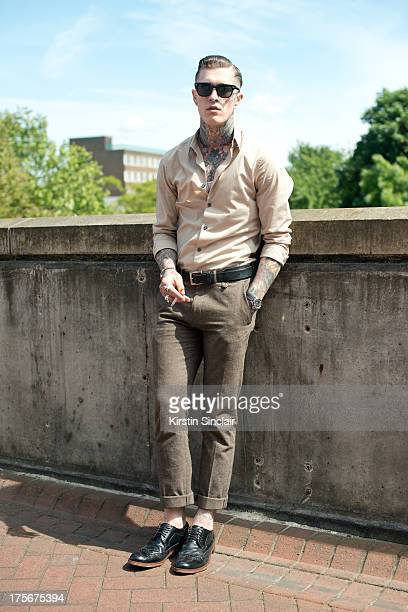 Model Jimmy Q wears vintage trousers and shirt Top Man shoes RayBan sunglasses The Great Frog jewellery and a Rolex watch on day 3 of Graduate...