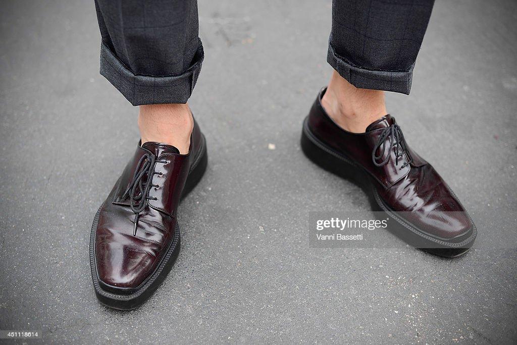 Model Jin Kay is seen wearing Mvio pants and Prada before Dirk Bikkembergs on June 23 2014 in Milan Italy