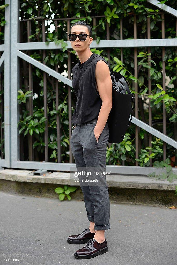 Model Jin Kay is seen wearing Mvio pants, Prada shoes and Rio Kairyu backpack before Dirk Bikkembergs showon June 23, 2014 in Milan, Italy.