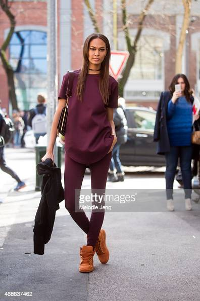 Model Joan Smalls exits the Fendi show in Adidas sneakers on Day 2 of Milan Fashion Week FW15 on February 26 2015 in Milan Italy