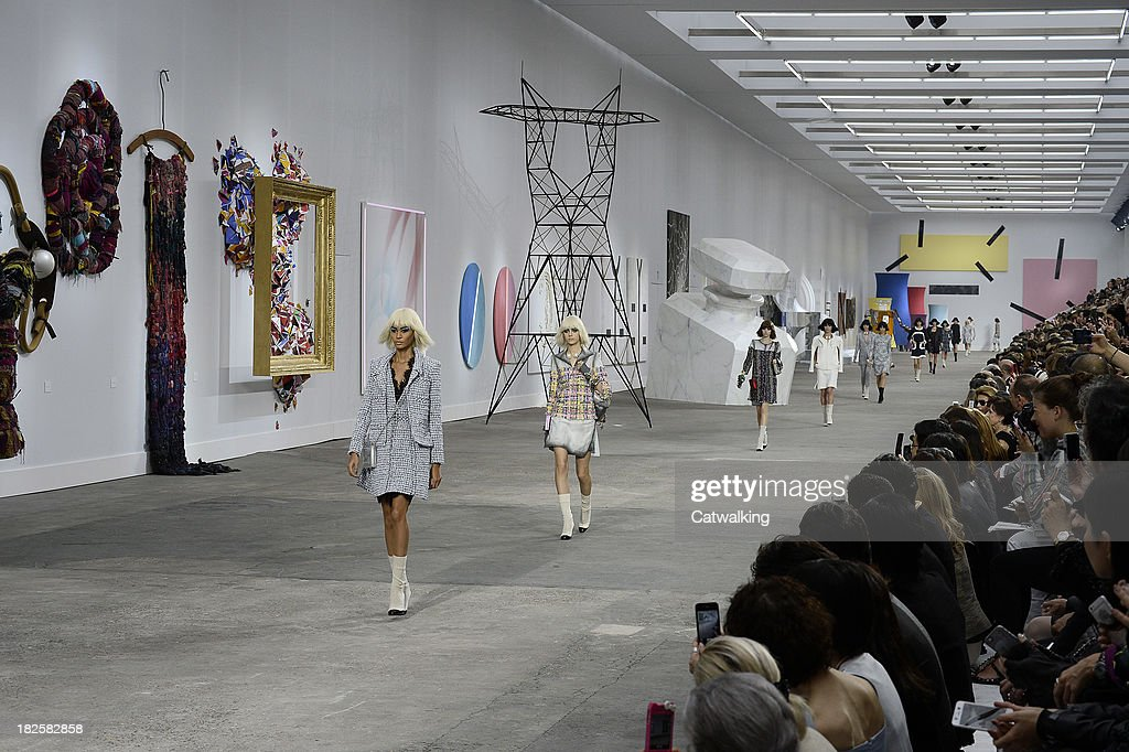 Model <a gi-track='captionPersonalityLinkClicked' href=/galleries/search?phrase=Joan+Smalls&family=editorial&specificpeople=5714628 ng-click='$event.stopPropagation()'>Joan Smalls</a> leads models down the runway at the Chanel Spring Summer 2014 fashion show during Paris Fashion Week on October 1, 2013 in Paris, France.