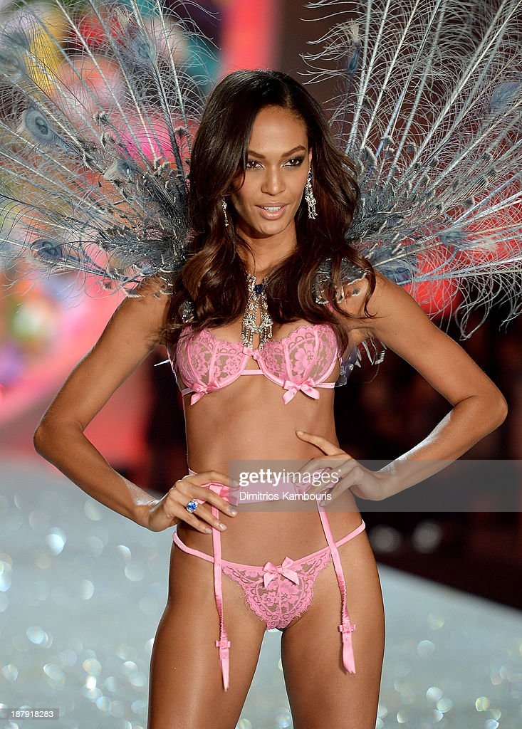 Model Joan Smalls walks the runway at the 2013 Victoria's Secret Fashion Show at Lexington Avenue Armory on November 13 2013 in New York City