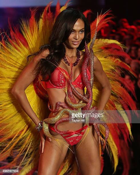 Model Joan Smalls walks the runway at the 2015 Victoria's Secret Fashion Show at Lexington Avenue Armory on November 10 2015 in New York City