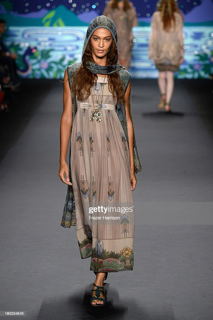 Model <a gi-track='captionPersonalityLinkClicked' href=/galleries/search?phrase=Joan+Smalls&family=editorial&specificpeople=5714628 ng-click='$event.stopPropagation()'>Joan Smalls</a> walks the runway at the Anna Sui fashion show during Mercedes-Benz Fashion Week Spring 2014 at The Theatre at Lincoln Center on September 11, 2013 in New York City.