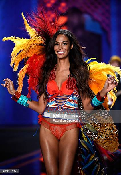 Model Joan Smalls walks the runway at the annual Victoria's Secret fashion show at Earls Court on December 2 2014 in London England