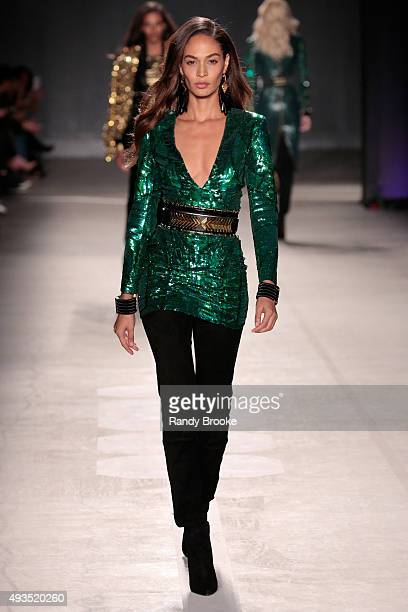 Model Joan Smalls walks the runway at the BALMAIN X HM Collection Launch at 23 Wall Street on October 20 2015 in New York City