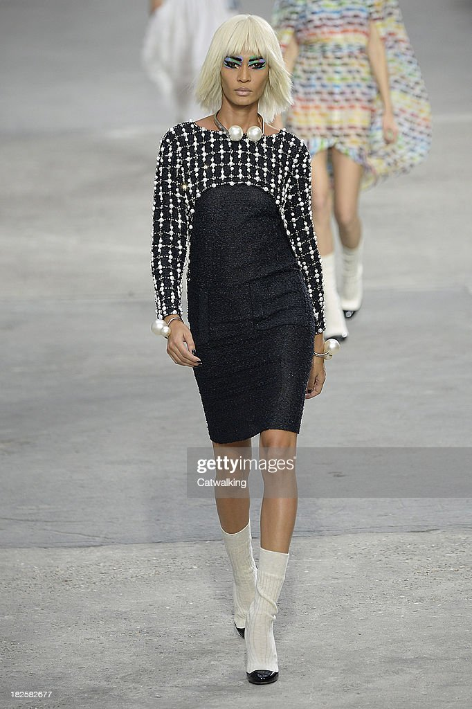 Model Joan Smalls walks the runway at the Chanel Spring Summer 2014 fashion show during Paris Fashion Week on October 1, 2013 in Paris, France.