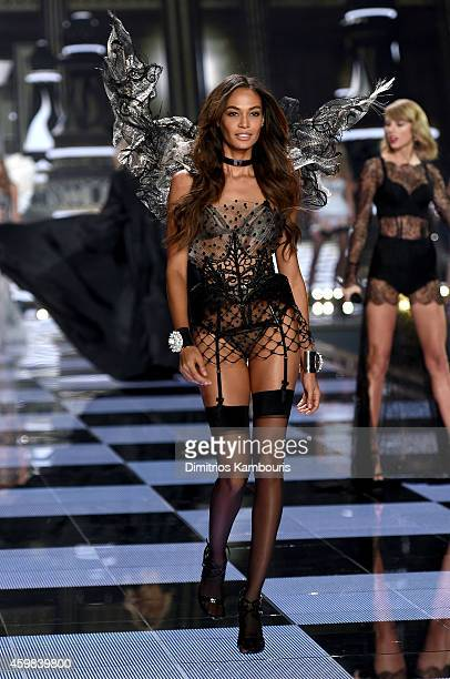 Model Joan Smalls walks the runway during the 2014 Victoria's Secret Fashion Show at Earl's Court Exhibition Centre on December 2 2014 in London...