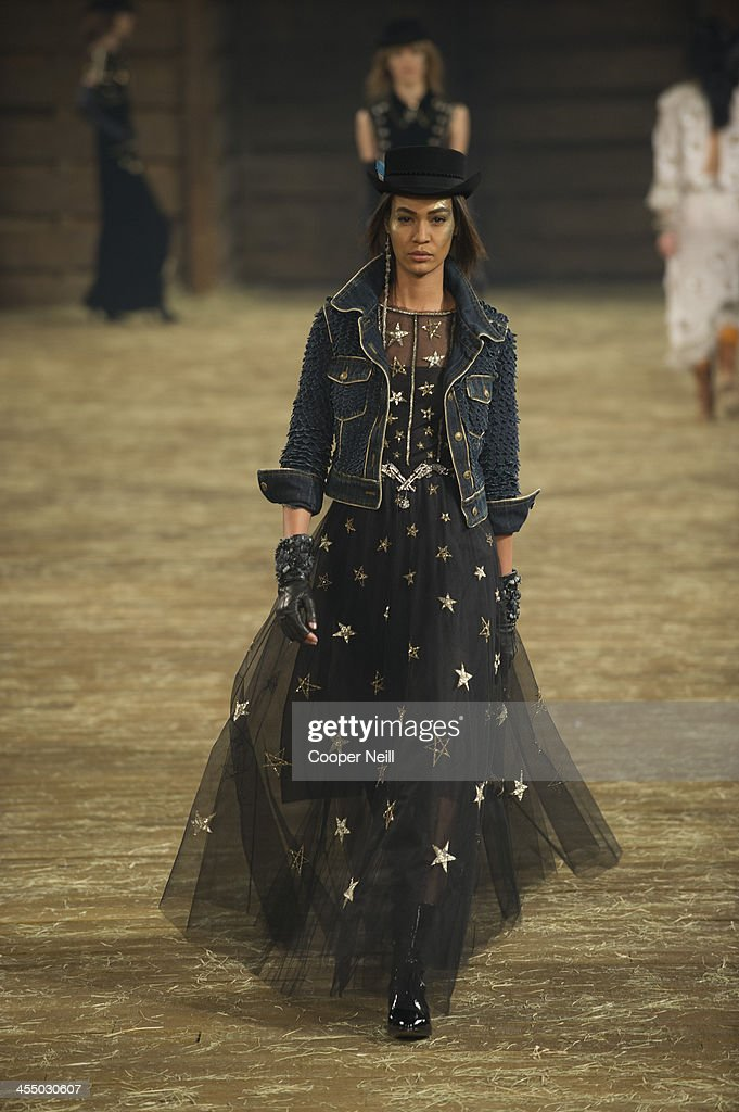 Model Joan Smalls walks the runway during the Chanel 'Metiers d'Art' Show at Fair Park on December 10, 2013 in Dallas, Texas.