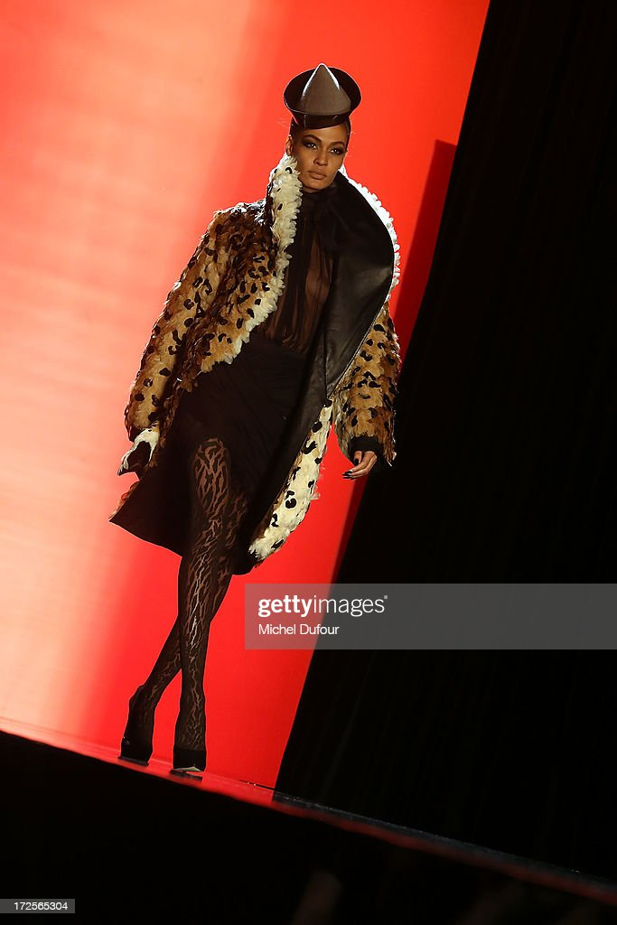 Model Joan Smalls walks the runway during the Jean Paul Gaultier show as part of Paris Fashion Week Haute-Couture Fall/Winter 2013-2014 at 325 Rue Saint Martin on July 3, 2013 in Paris, France.
