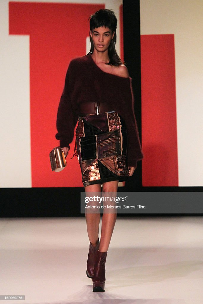 Model Joan Smalls walks the runway during theJean Paul Gaultier Fall/Winter 2013 Ready-to-Wear show as part of Paris Fashion Week on March 2, 2013 in Paris, France.