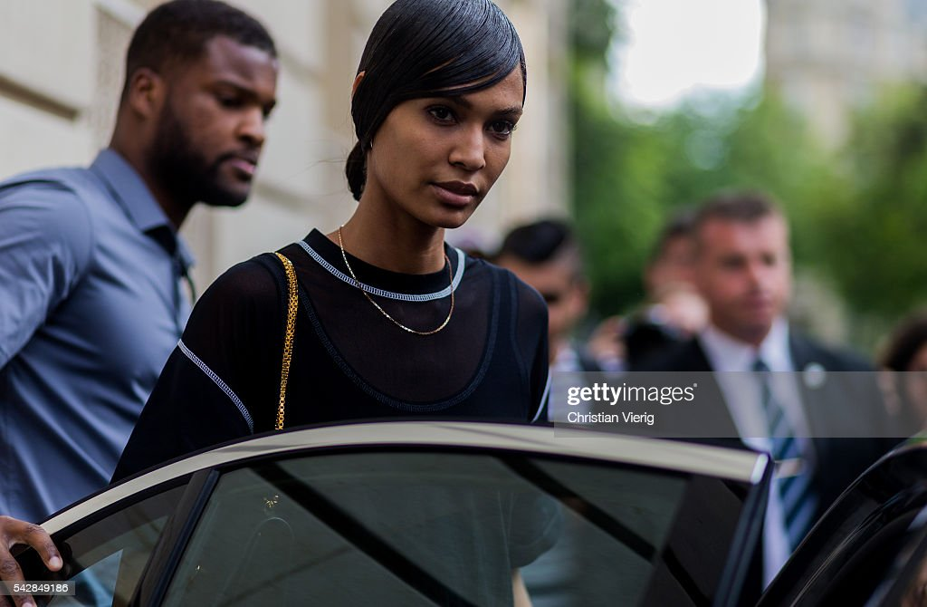 Model <a gi-track='captionPersonalityLinkClicked' href=/galleries/search?phrase=Joan+Smalls&family=editorial&specificpeople=5714628 ng-click='$event.stopPropagation()'>Joan Smalls</a> with wet hair outside Givenchy during the Paris Fashion Week Menswear Spring/Summer 2017 on June 24, 2016 in Paris, France.
