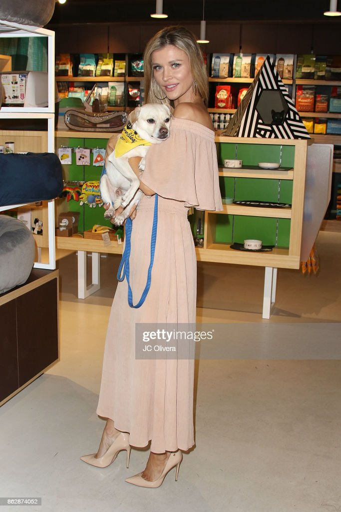 Model Joanna Krupa attends a press conference celebrating Calfornia Governor Jerry Brown signing California assembly Bill 485: The Pet Rescue and Adoption Act banning the sales of dogs, cats, and rabbits in retail stores at Healthy Spot on October 18, 2017 in Los Angeles, California.