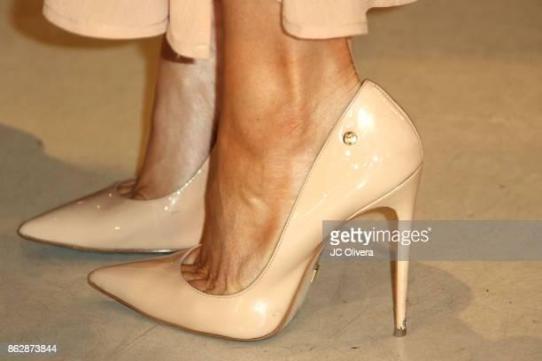 Model Joanna Krupa shoes detail attends a press conference celebrating Calfornia Governor Jerry Brown signing California assembly Bill 485 The Pet...