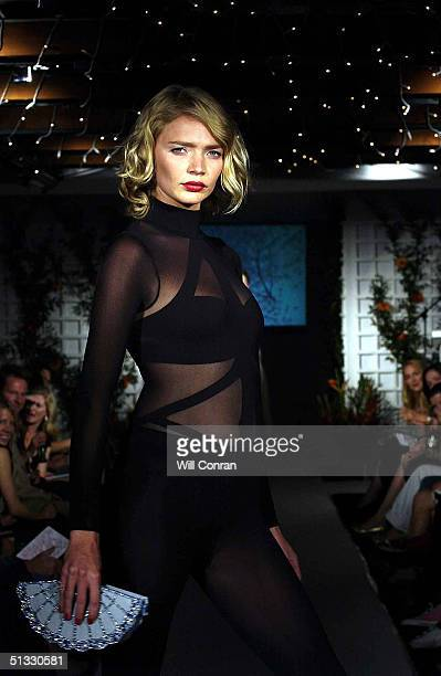 Model Jodie Kidd participates in the 'Clothesline' Gala Fashion Show at The Chelsea Gardner Sydney Street on September 20 2004 in London The catwalk...