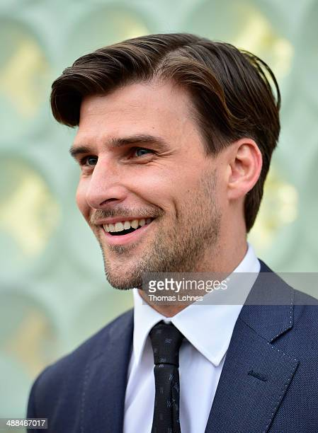 Model Johannes Huebl poses on the red carpet at the Louis Vuitton Glabal Store Opening on May 6 2014 in Frankfurt am Main Germany
