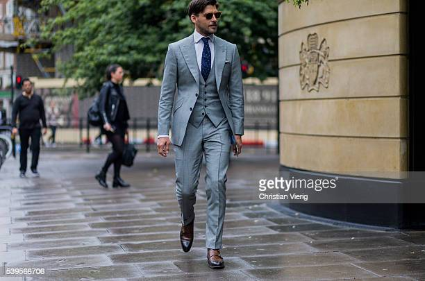 Model Johannes Huebl wearing a grey suit vest and tie outside Christopher Raeburn during The London Collections Men SS17 on June 12 2016 in London...