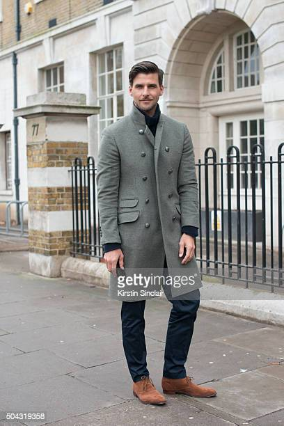 Model Johannes Huebl wears a Brunello Cucinelli coat Etro top and Crockett and Jones shoes on day 2 of London Collections Men on Januay 9 2016 in...