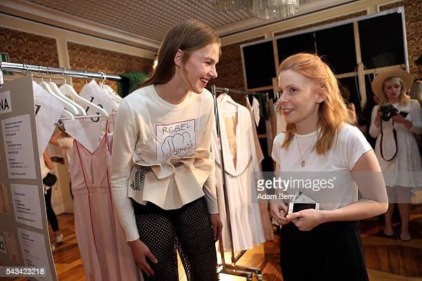 A model jokes with fashion designer Malaika Raiss backstage ahead of the Malaikaraiss show during the MercedesBenz Fashion Week Berlin Spring/Summer...