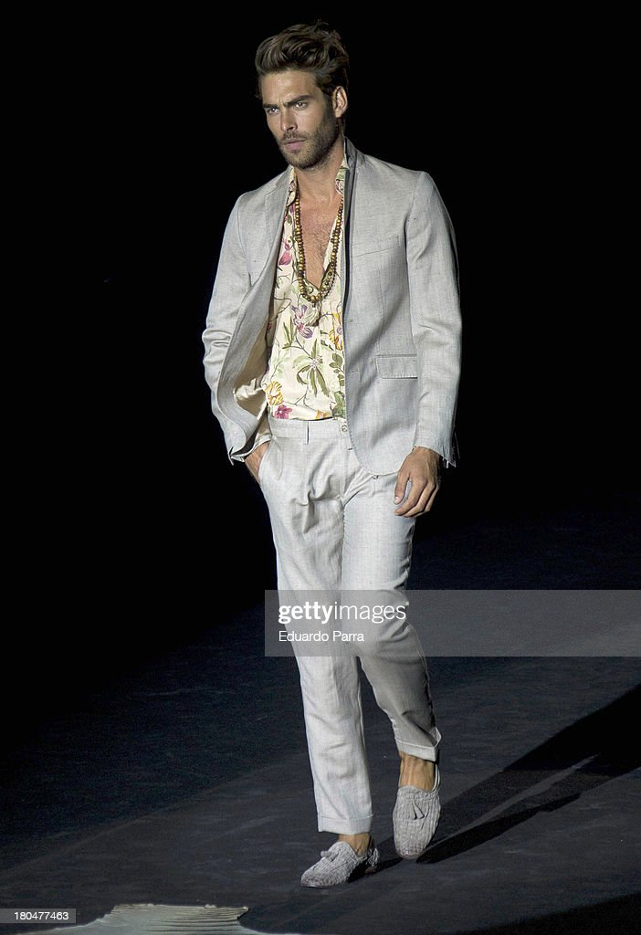 Model <a gi-track='captionPersonalityLinkClicked' href=/galleries/search?phrase=Jon+Kortajarena&family=editorial&specificpeople=4684429 ng-click='$event.stopPropagation()'>Jon Kortajarena</a> showcases designs by Roberto Verino on the runway at Roberto Verino show during Mercedes Benz Fashion Week Madrid Spring/Summer 2014 at Ifema on September 13, 2013 in Madrid, Spain.