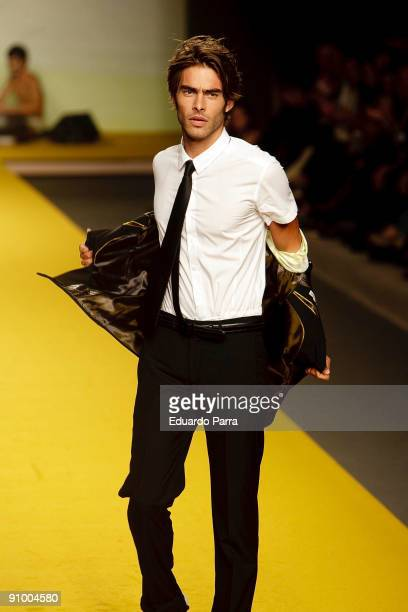 Model Jon Kortajarena undresses on the runway at the Antonio Miro show during Cibeles Madrid Fashion Week Spring/Summer 2010 at Pasarela Cibeles on...