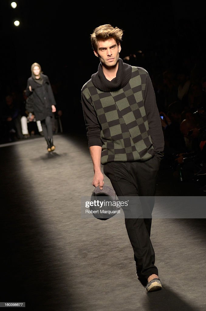 Model Jon Kortajarena walks the runway during the Miriam Ponsa fashion show as part of the 080 Barcelona Fashion Week Autumn/Winter 2013-2014 on January 30, 2013 in Barcelona, Spain.
