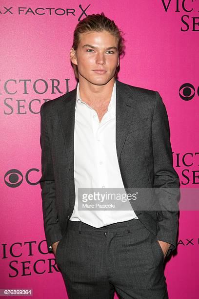 Model Jordan Barrett attends '2016 Victoria's Secret Fashion Show' Pink carpet photocall at Le Grand Palais on November 30 2016 in Paris France
