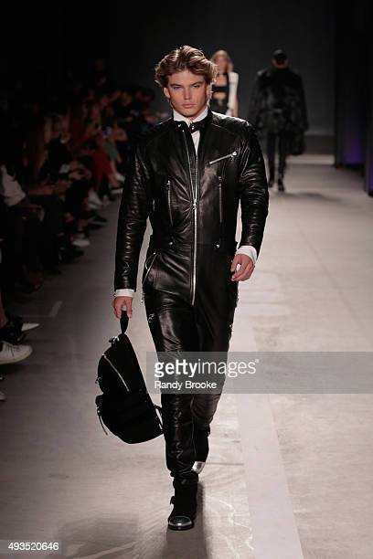 Model Jordan Barrett walks the runway at the BALMAIN X HM Collection Launch at 23 Wall Street on October 20 2015 in New York City