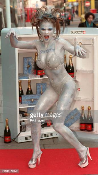 Model Jordan body painted as the Ice Maiden poses for the media during a photocall in London's Covent Garden today December 6 where she launched the...