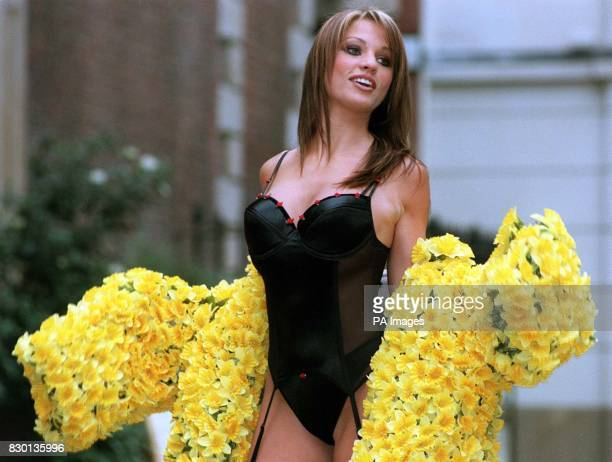 Model Jordan shows off Sock shop's new Valentine's basque after removing a specially designed coat made from daffodil badges the symbol used by the...