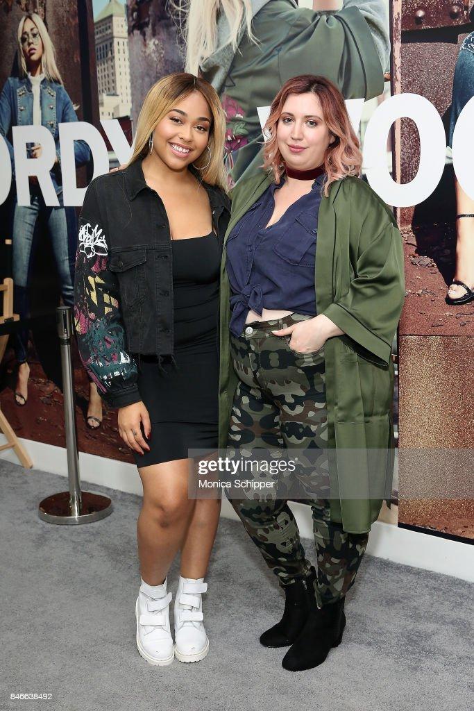 Model Jordyn Woods (L) and host Liz Black pose for a photo at the Jordyn Woods meet & greet at Addition Elle on September 13, 2017 in New York City.