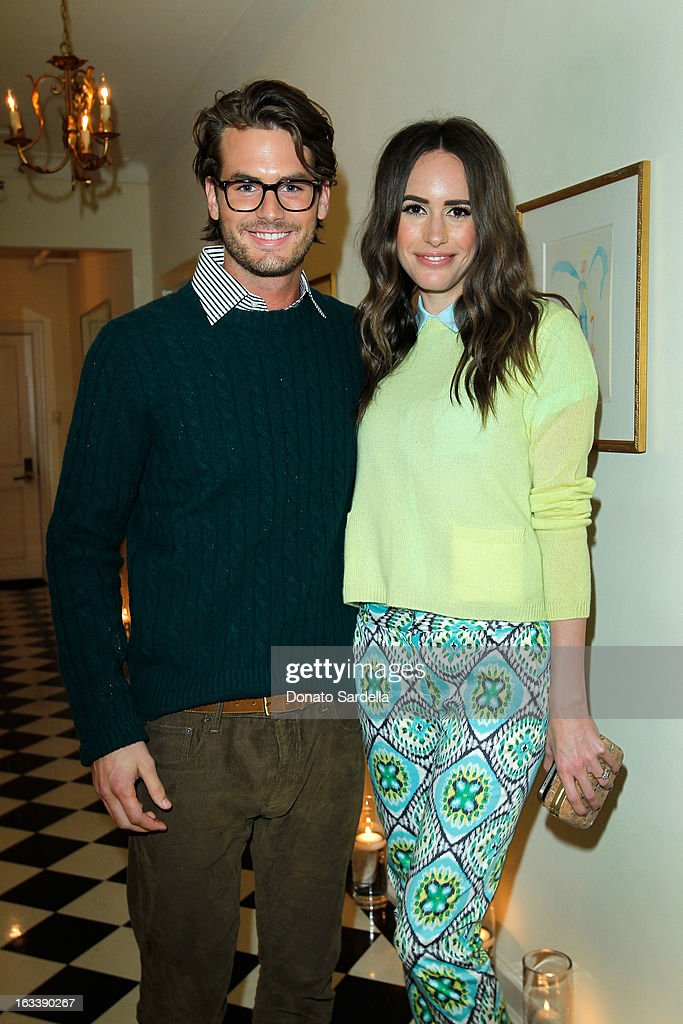 Model Josh Slack and television personality Louise Roe attends Joe Fresh private dinner hosted by Joe Mimran and Kate Mara at The Chateau Marmont on March 8, 2013 in Los Angeles, California.