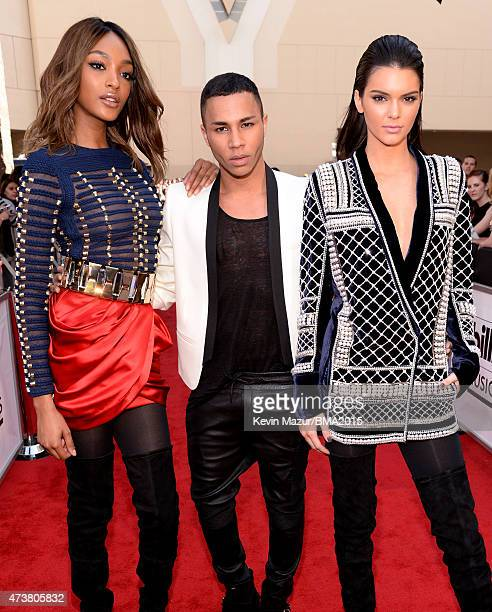 Model Jourdan Dunn fashion designer Olivier Rousteing and TV personality Kendall Jenner all wearing Balmain x HM attend the 2015 Billboard Music...