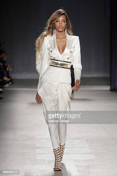 Model Jourdan Dunn walks the runway wearing BALMAIN X HM collection during the launch event at 23 Wall Street on October 20 2015 in New York City