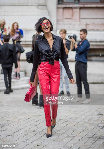 Model Jourdan Dunn wearing black blouse red leather pants is seen outside Balmain during Paris Fashion Week Spring/Summer 2018 on September 28 2017...