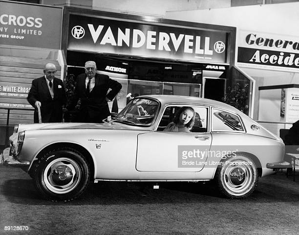 Model Judy Wragg in the driving seat of the new Honda S800 coupe on display at the International Motor Show at Earl's Court London 18th October 1966