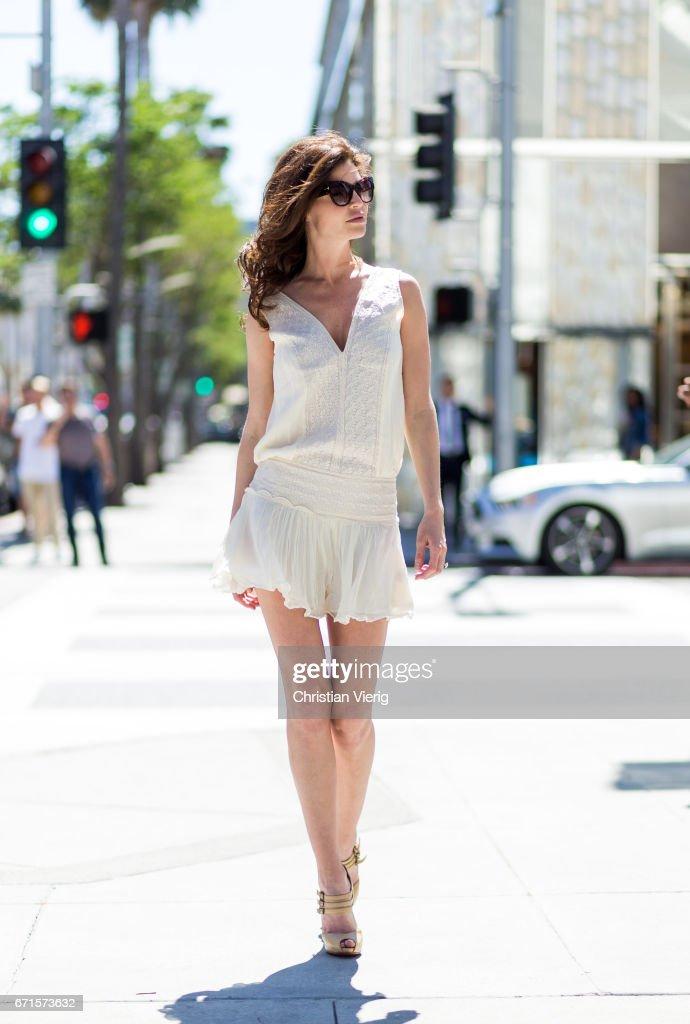Model Julia Lescova wearing a Magali Pascal dress, Christian Louboutin shoes on April 21, 2017 in Los Angeles, California.