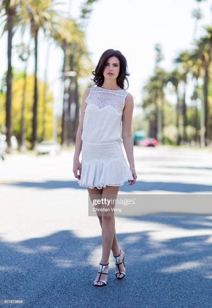Model Julia Lescova wearing a white dress Magali Pascal, shoes Gianvito Rossi on April 21, 2017 in Los Angeles, California.
