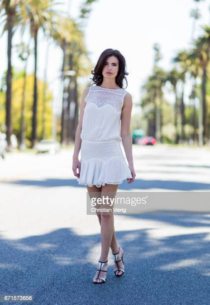 Model Julia Lescova wearing a white dress Magali Pascal shoes Gianvito Rossi on April 21 2017 in Los Angeles California