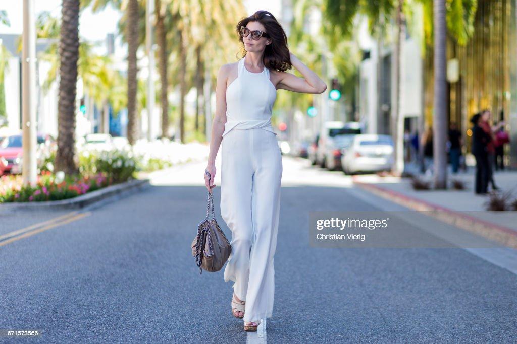 Model Julia Lescova wearing a white jumpsuit Ramy Brook New York, Chloe shoes, Stella McCartney bag, Celine sunglasses on April 21, 2017 in Los Angeles, California.