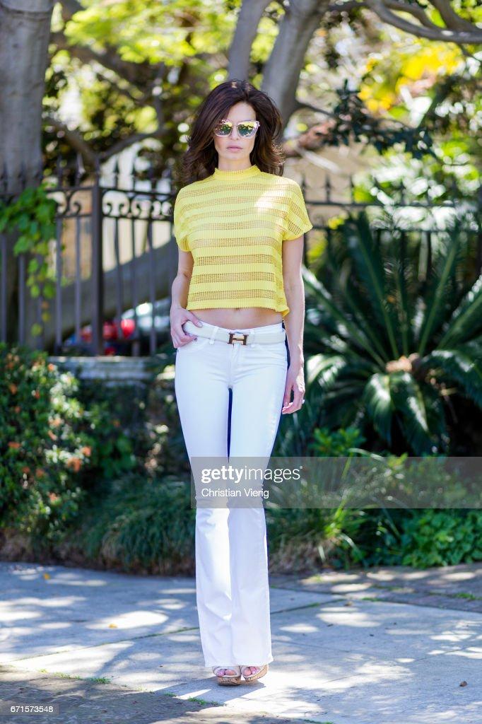 Model Julia Lescova wearing white jeans Rag&Bone, French Mauve yellow striped top, Chloe shoes, Celine sunglasses, Chanel bag on April 21, 2017 in Los Angeles, California.