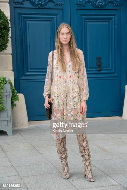 Model Julia Necker wear an HM dress vintage boots and bag day 2 of Paris Haute Couture Fashion Week Autumn/Winter 2017 on July 3 2017 in Paris France