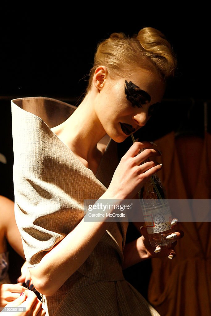 Model Julia Nobis has a water backstage ahead of the Phoenix Keating show during Mercedes-Benz Fashion Week Australia Spring/Summer 2013/14 at Carriageworks on April 11, 2013 in Sydney, Australia.