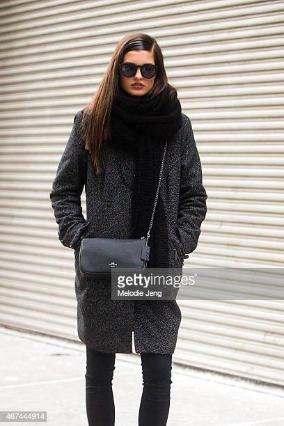 Model Julia Van Os exits the Donna Karan show with a Coach purse on Day 6 of New York Fashion Week Fall 2015 on February 16 2015 in New York City
