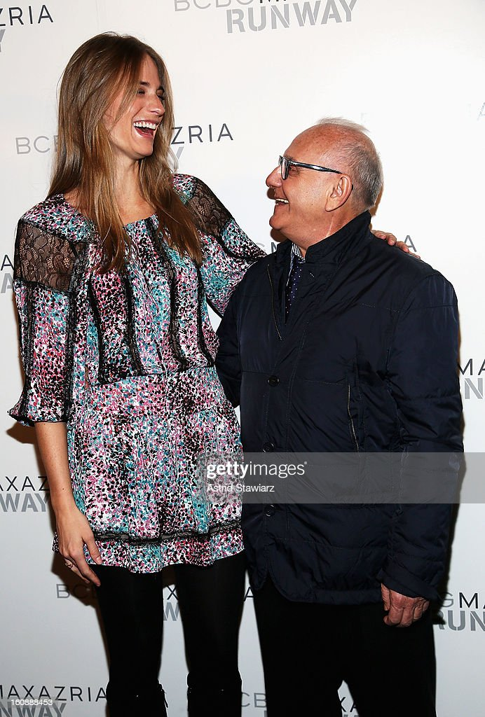Model <a gi-track='captionPersonalityLinkClicked' href=/galleries/search?phrase=Julie+Henderson&family=editorial&specificpeople=4154524 ng-click='$event.stopPropagation()'>Julie Henderson</a> and Designer Max Azria pose backstage at the BCBGMAXAZRIA Fall 2013 fashion show during Mercedes-Benz Fashion Week at The Theatre at Lincoln Center on February 7, 2013 in New York City.